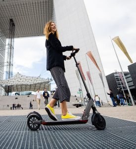 woman-riding-e-twow-electric-scooter-London-Personal-Electric-Scooter