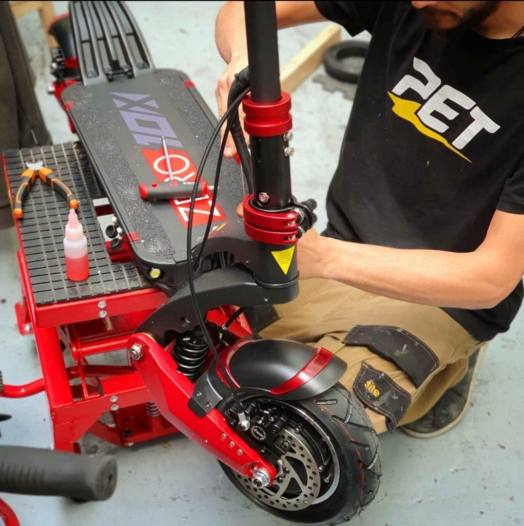 Nikos Repairing an Electric Scooter at Personal Electric Transport Repair Centre